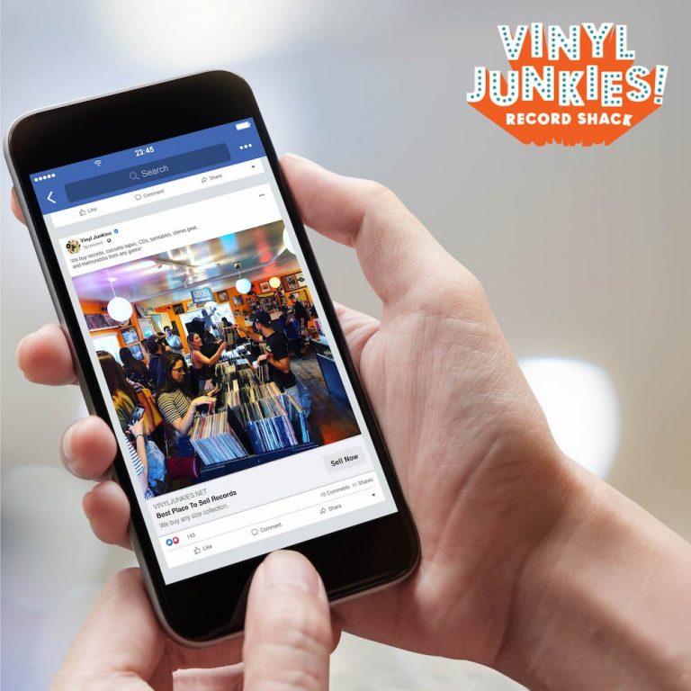 mobile phone with a Vinyl Junkies digital advertising