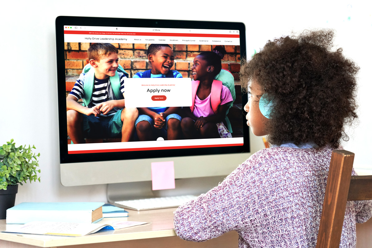 Girl viewing the Holly Drive Leadership Academy website on a desktop